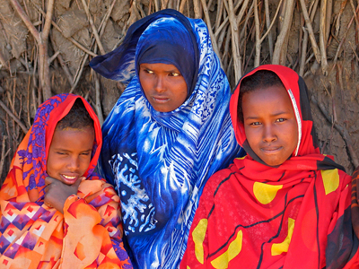 Three Ethiopian Girls Wearing Traditional Modest Clothing